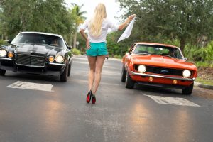 Model with vintage Camero's - Classic car photography